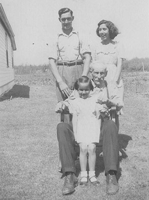 John, Evelyn and Beatrice Begg with Grandpa Robert